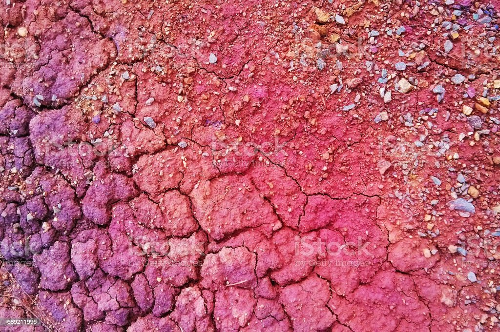 Travel to Ural, Russia. The view on the red and purple dry cracked soil for background. stock photo