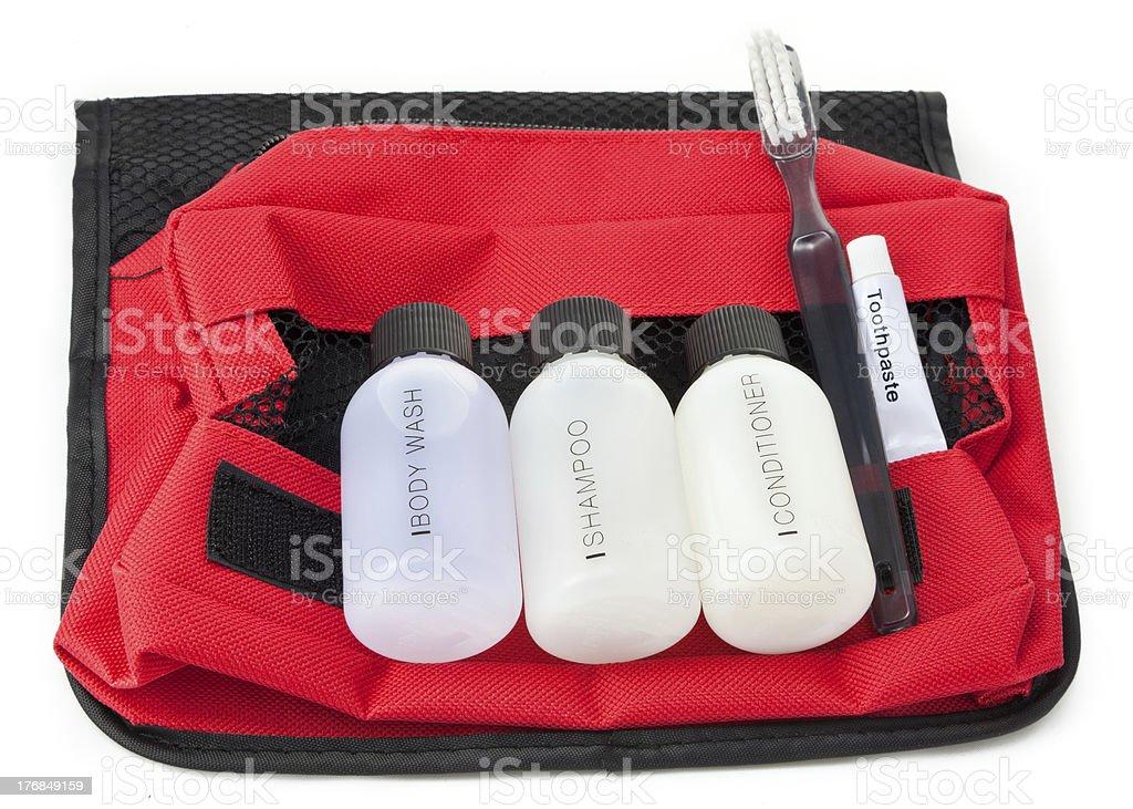Travel toiletries kit on a red bag stock photo