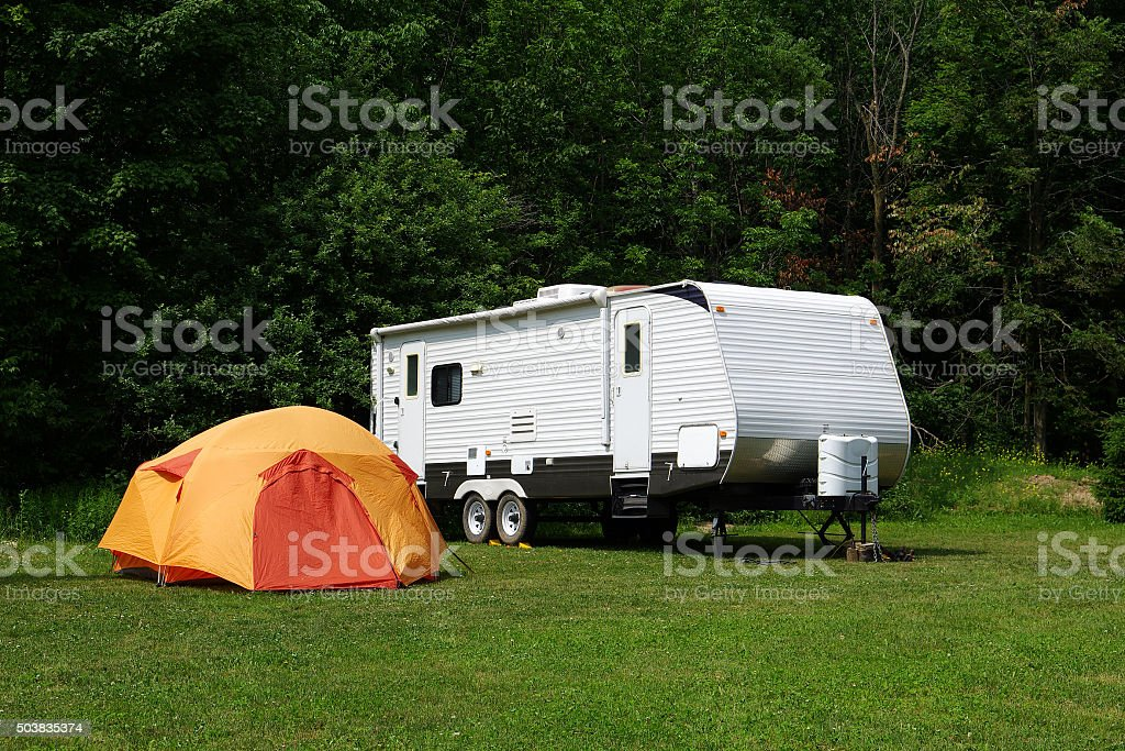 Travel Trailer and Tent stock photo