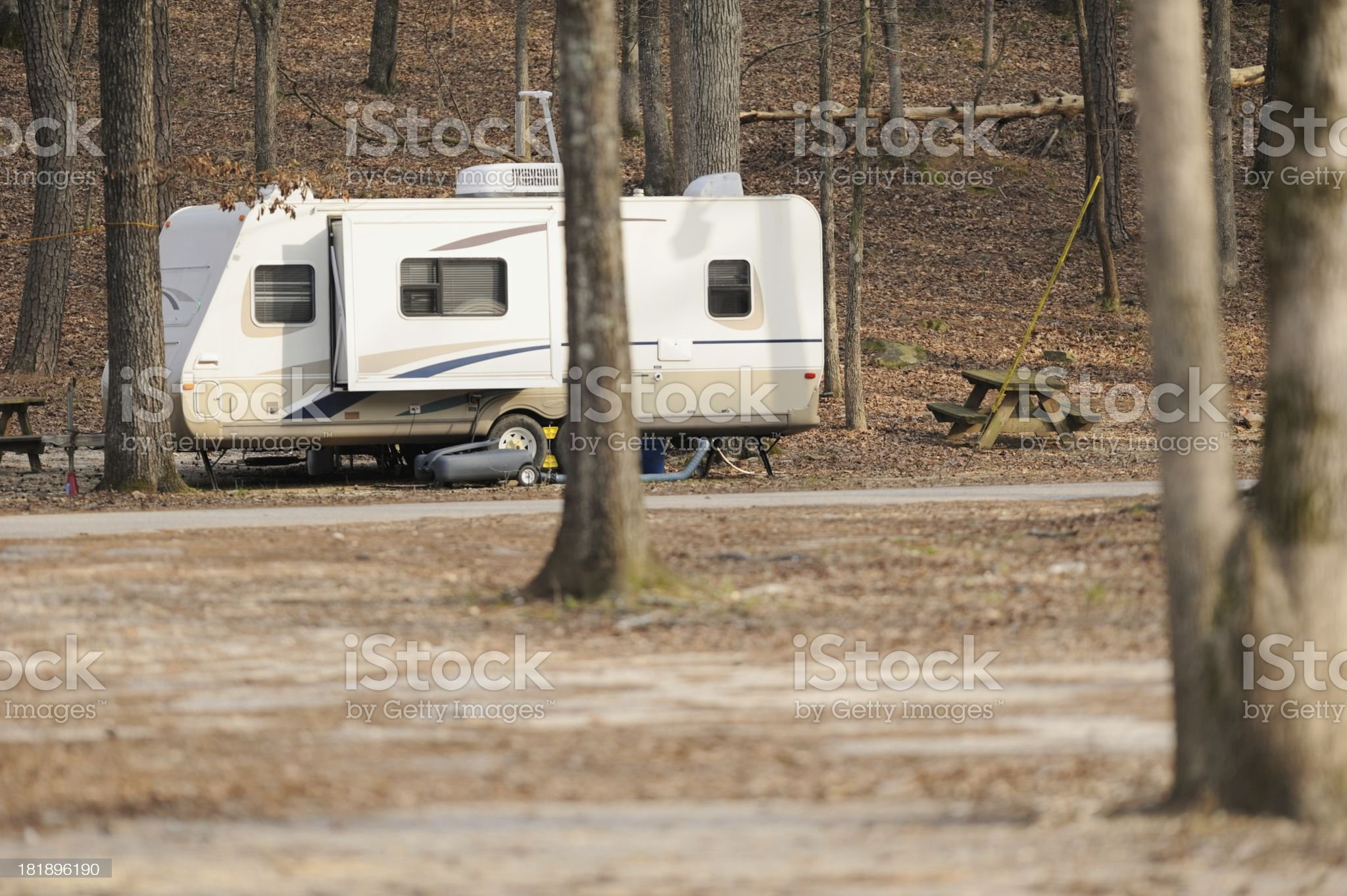 Travel trailer camper in campground royalty-free stock photo