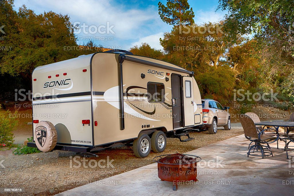 Travel trailer in campground stock photo