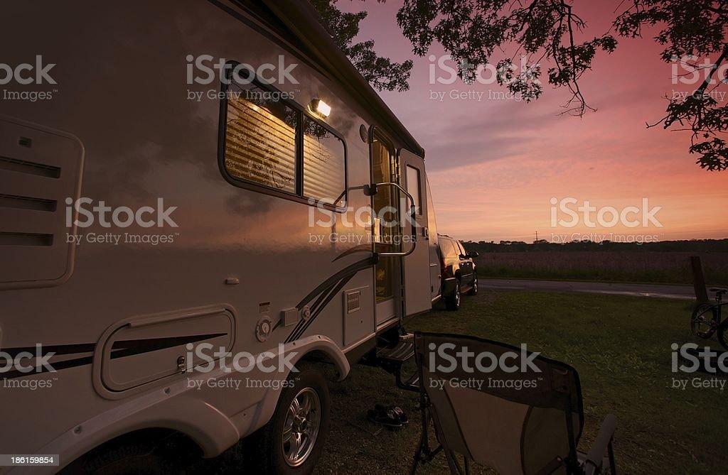 Travel Trailer in Sunset stock photo