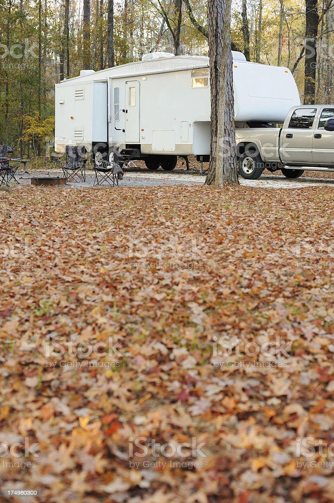 Travel trailer rv in autumn campsite royalty-free stock photo
