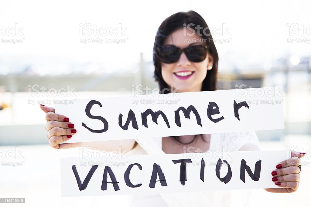 Travel Vacations:  Young woman wearing sunglasses on vacation royalty-free stock photo