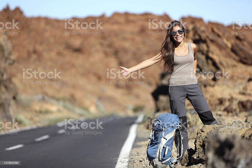 Travel woman hitchhiking stock photo