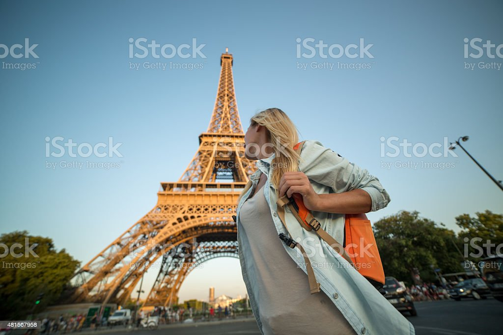 Travel woman in Paris at the Eiffel tower stock photo