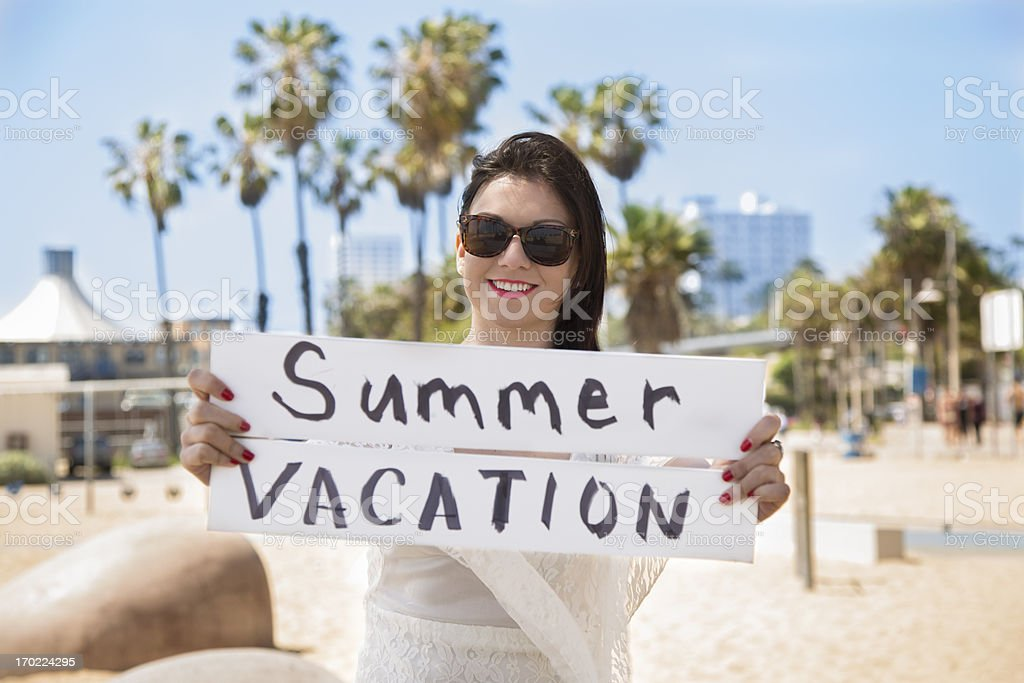 Travel:  Young adult woman. Summer vacation signs. Santa Monica beach. stock photo