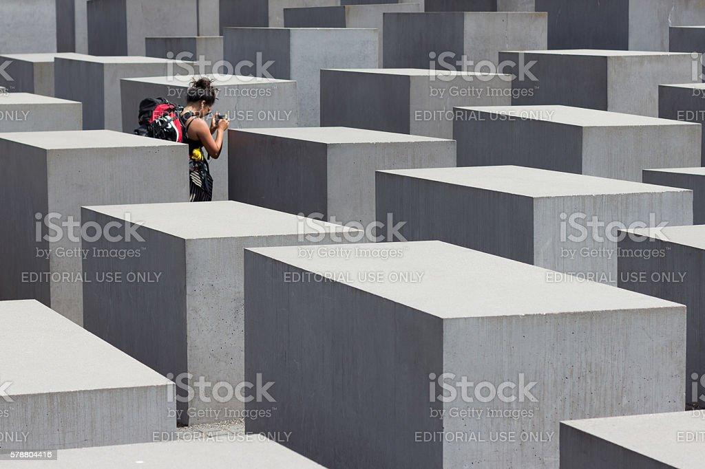 Traveler at Holocaust memorial / jewish memorial in Berlin stock photo