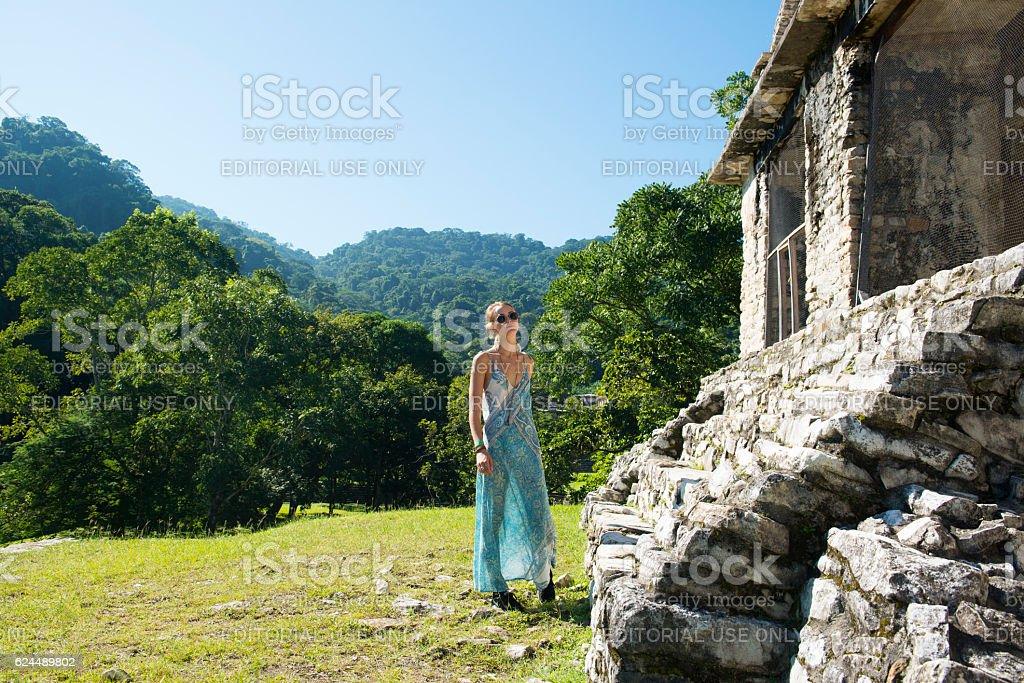Traveler at Mayan ruins in Palenque, Mexico stock photo