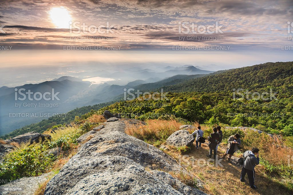 Traveler backpacker stand on the cliff . stock photo