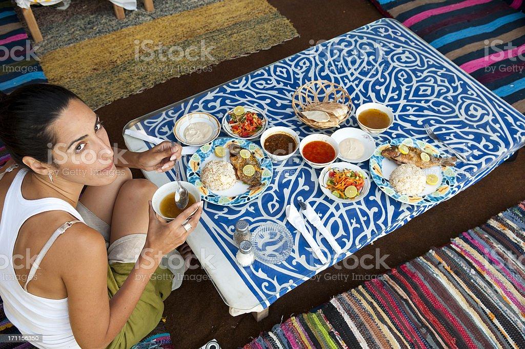 Traveler eating dinner in Egypt stock photo