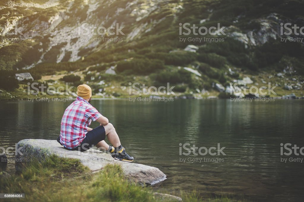 Traveler enjoying the view at the lake stock photo