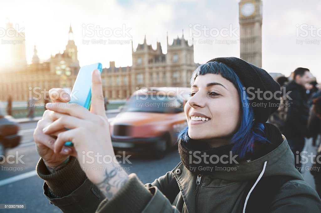 Traveler girl using smartphone stock photo