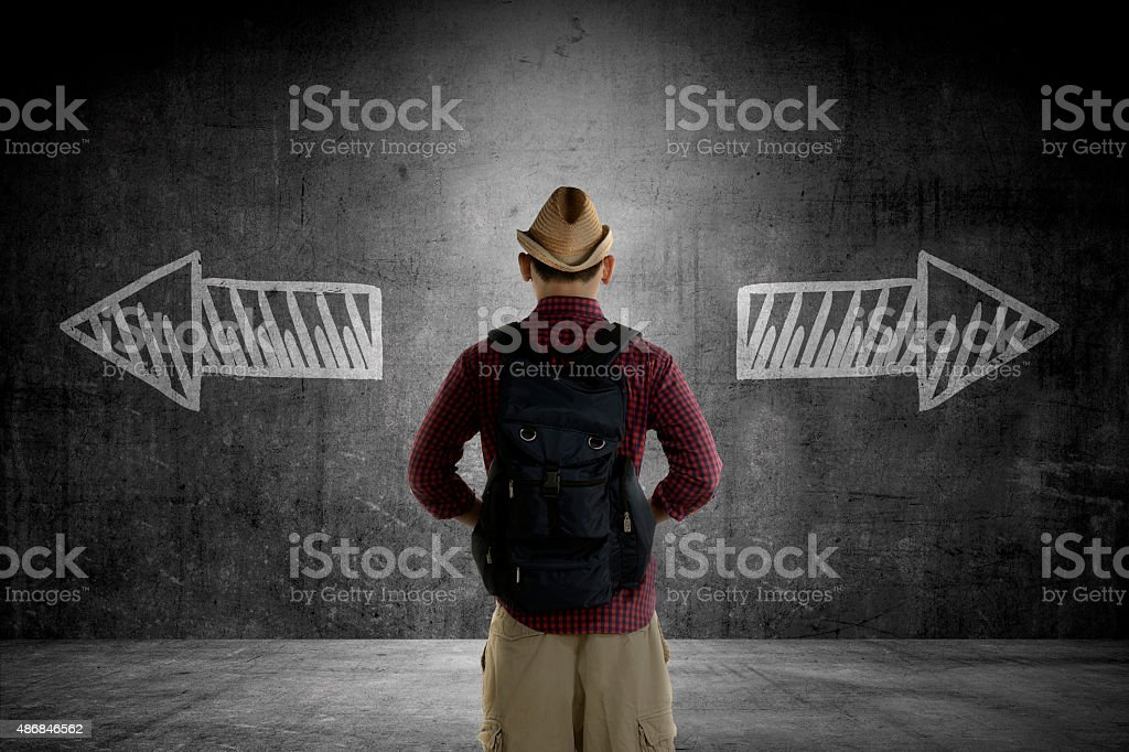 Traveler has to choose between two way stock photo