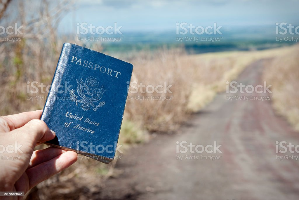 Traveler holding U.S. Passport on road in Nicaragua stock photo