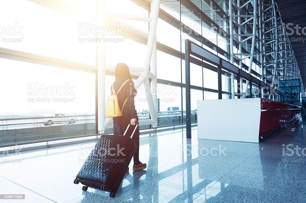 traveler in airport stock photo