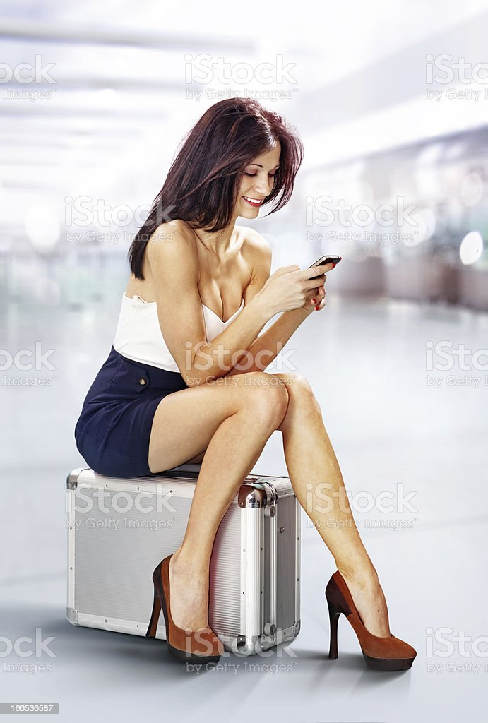 traveler in airport with phone royalty-free stock photo