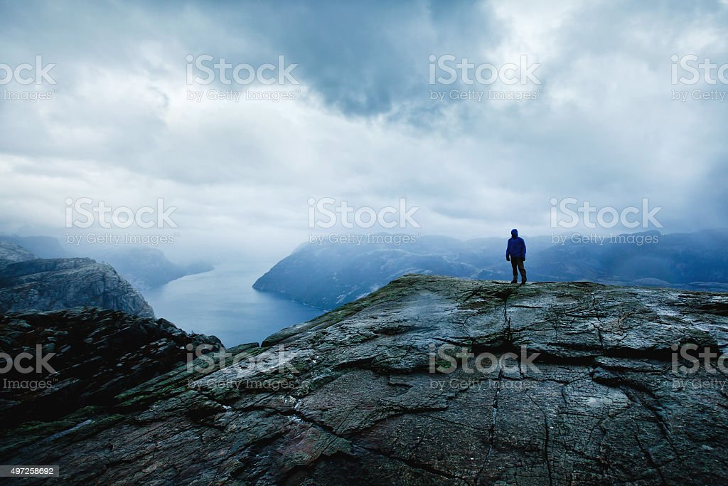traveler looking on the fjords, hiking in Norway stock photo