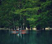 Traveler man kayaking on lake