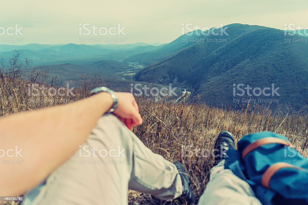 Traveler man resting in the mountains stock photo