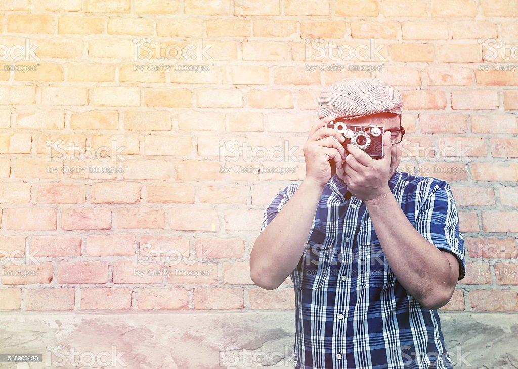 Traveler man wear plaid shirt with a camera. stock photo