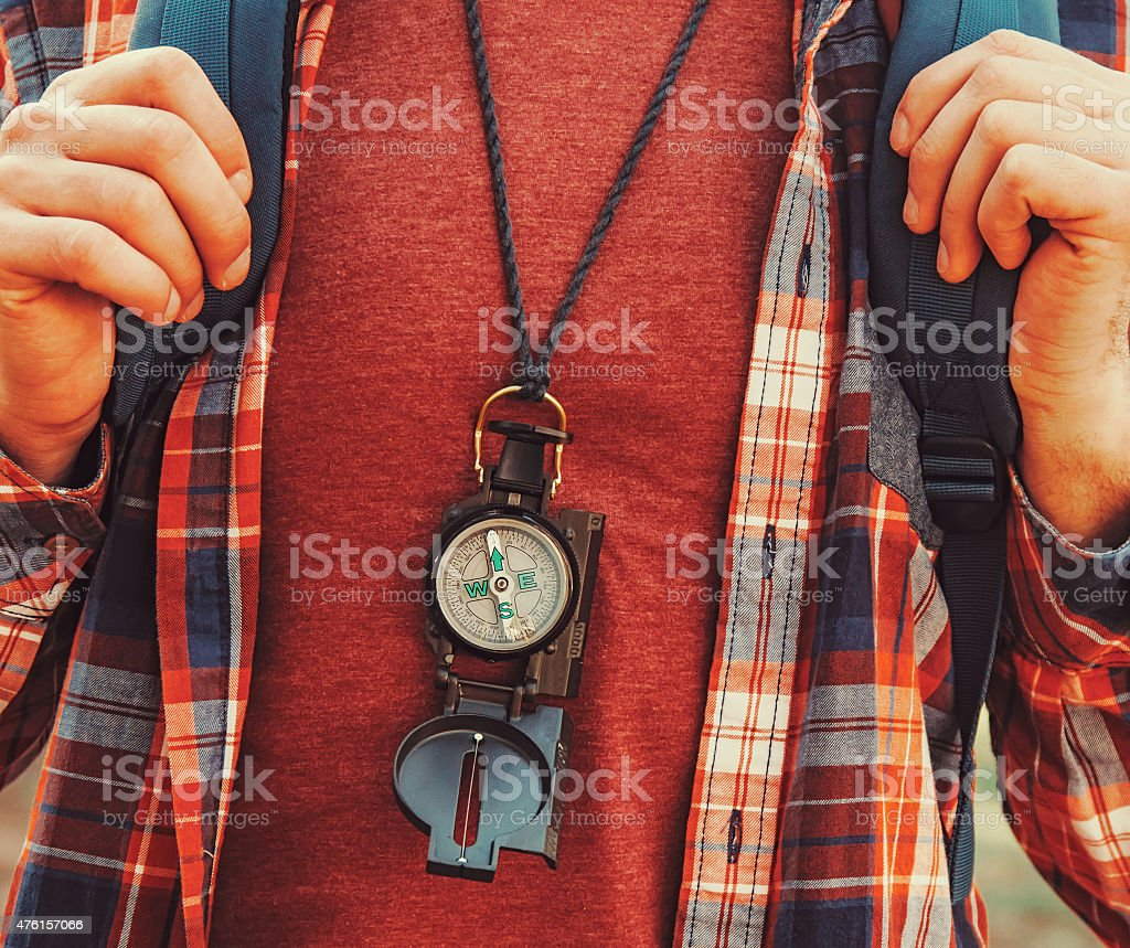 Traveler man with a compass stock photo