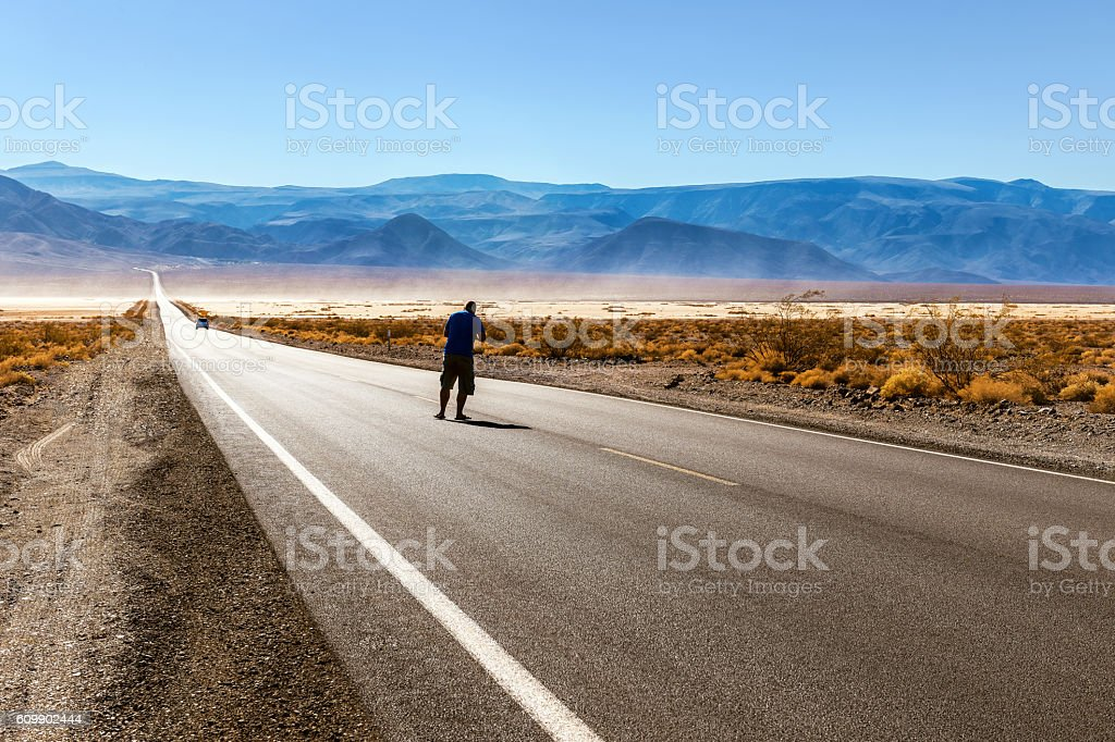 Traveler on the Road 190 in Death Valley , California, USA stock photo