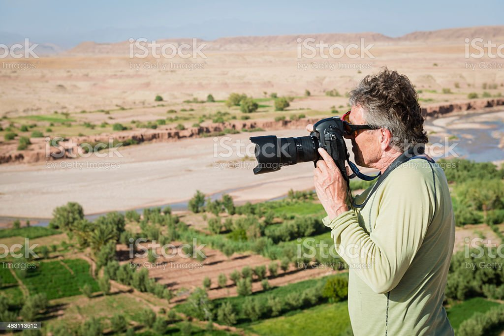 Traveler Photographing A?t Ben Haddou, Morocco, North Africa stock photo