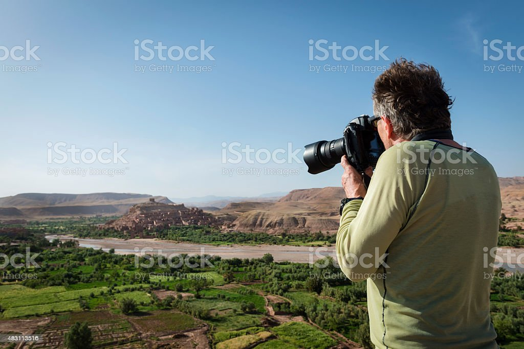 Traveler Photographing Evening A?t Ben Haddou, Morocco, North Africa stock photo
