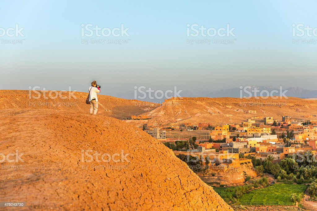 Traveler photographing morning A?t Ben Haddou,  Morocco, North Africa stock photo