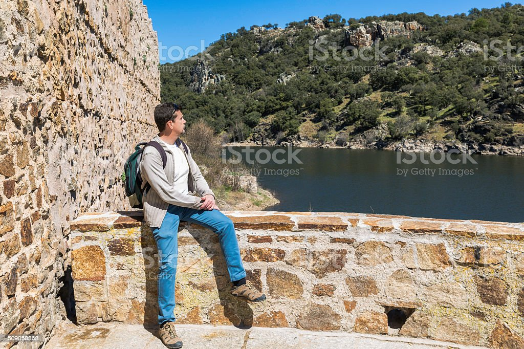 traveler resting close to the river. Countryside stock photo