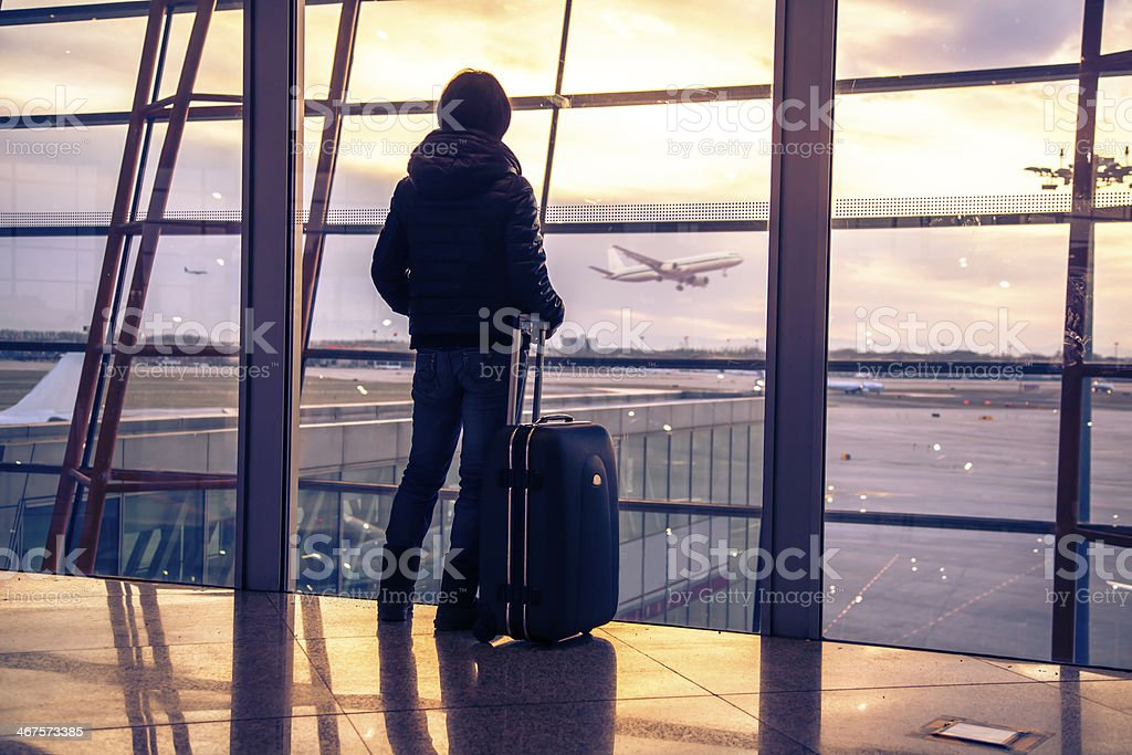 Traveler silhouettes at airport,Beijing stock photo