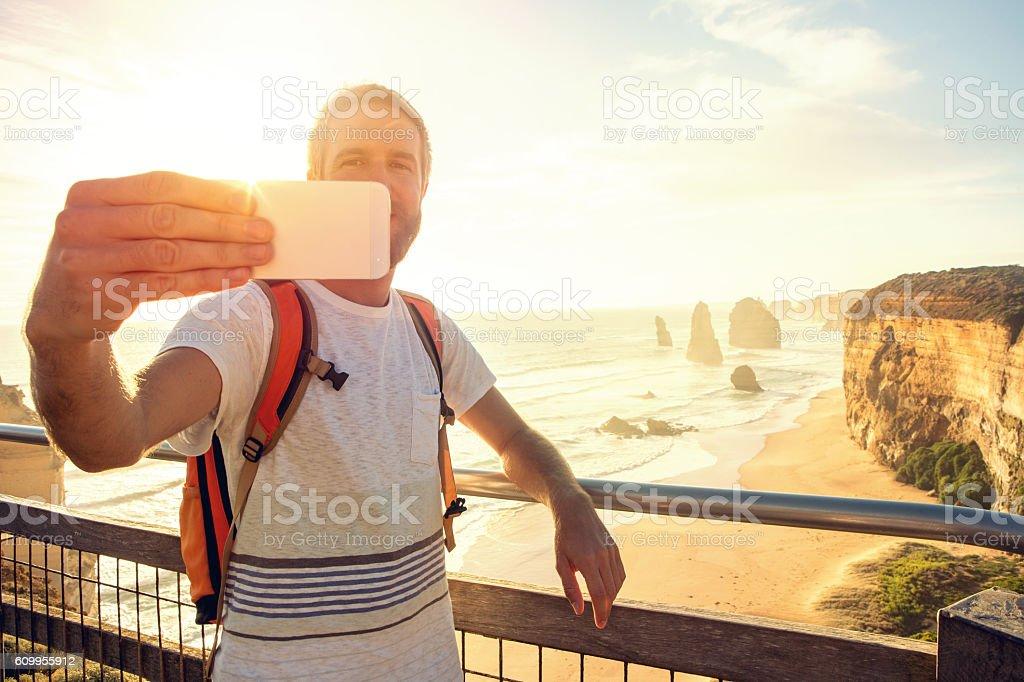 Traveler takes selfie at the Twelve apostles, sunset stock photo