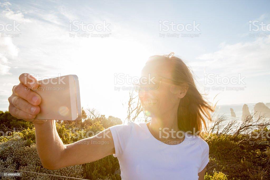 Traveler takes selfie with Twelve Apostles sea rocks-Australia stock photo