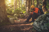 Traveler uses smartphone in the woods