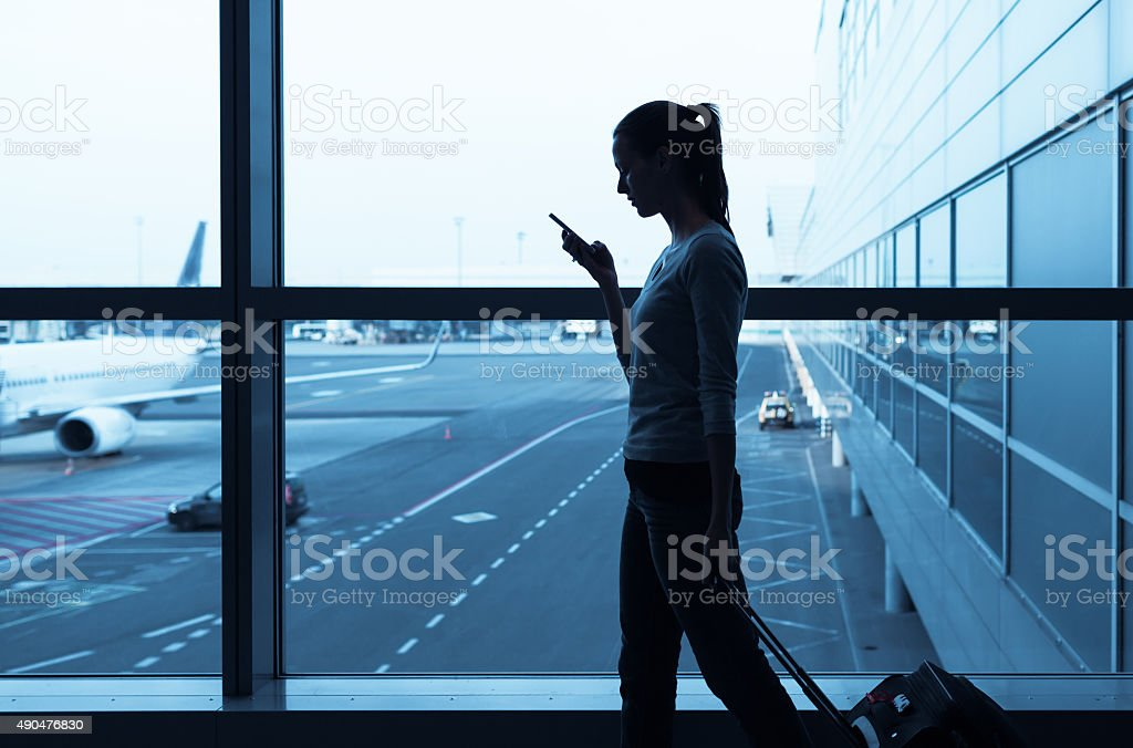 Traveler using her phone stock photo