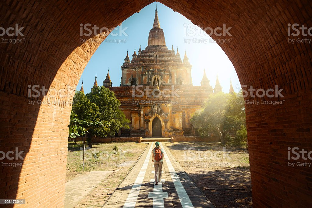 Traveler walking along road to Htilominlo temple in Bagan. Burma stock photo
