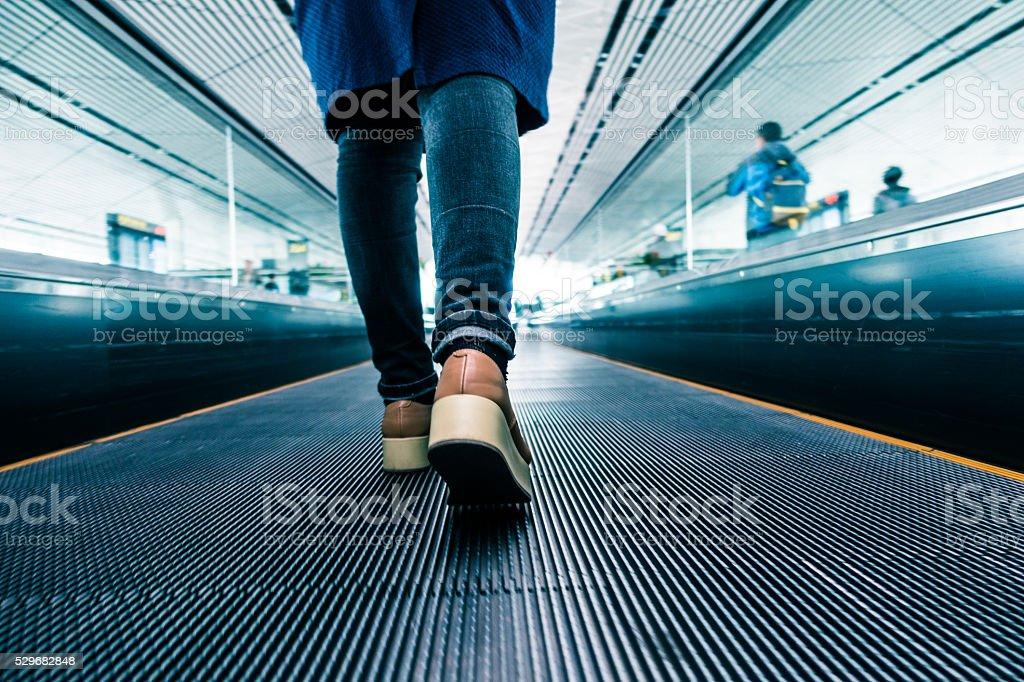 Traveler walking in airport stock photo