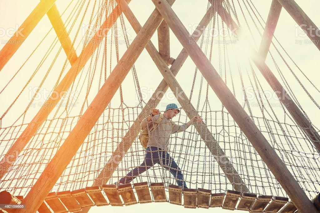 traveler walking over bridge stock photo
