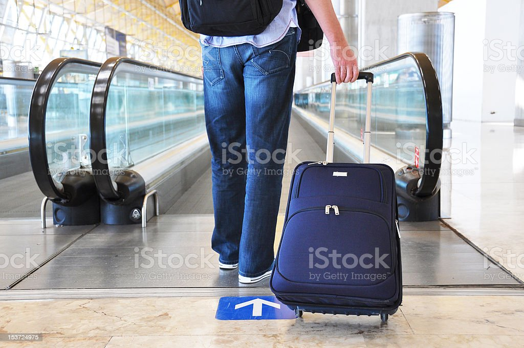 Traveler with a bag at the speedwalk stock photo