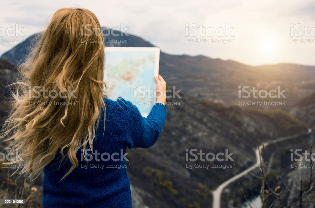 Traveler with map stock photo