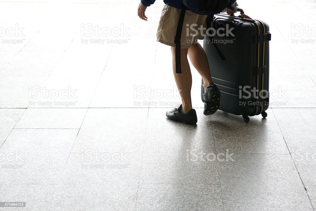 Traveler with Shorts and Suitcase royalty-free stock photo