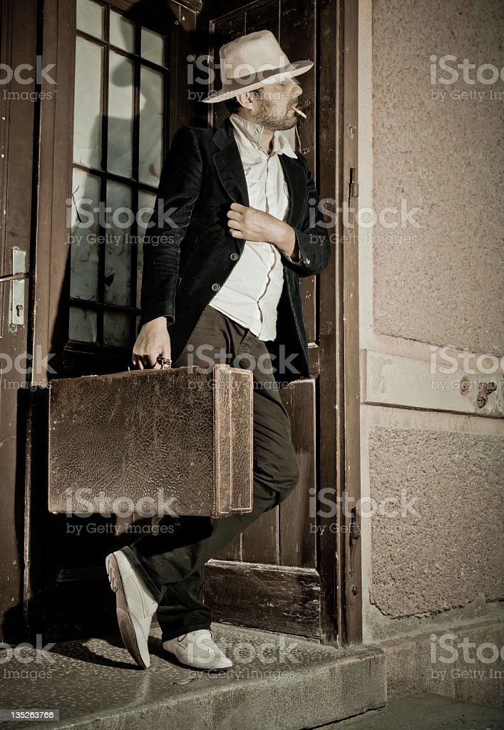 Traveler with suitcase royalty-free stock photo