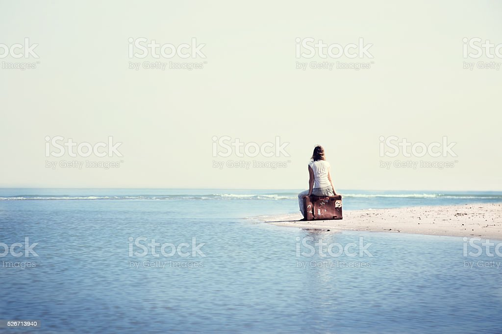 traveler woman resting in front the spectacular ocean stock photo