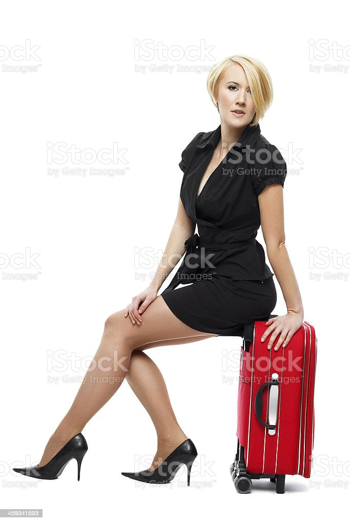 Traveler woman sit on suitcase royalty-free stock photo
