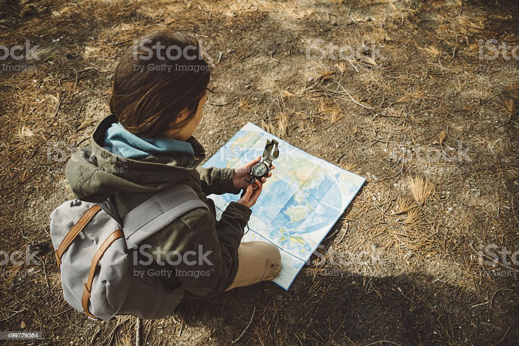 Traveler woman with a compass and map outdoor stock photo