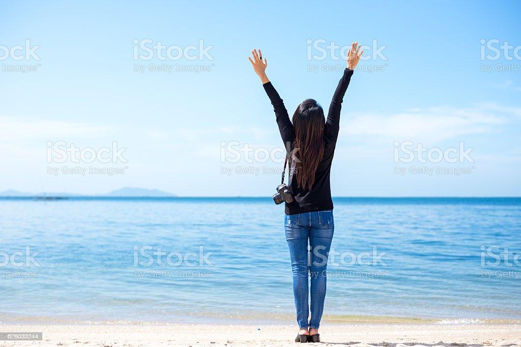 Traveler women see the beautiful beach stock photo