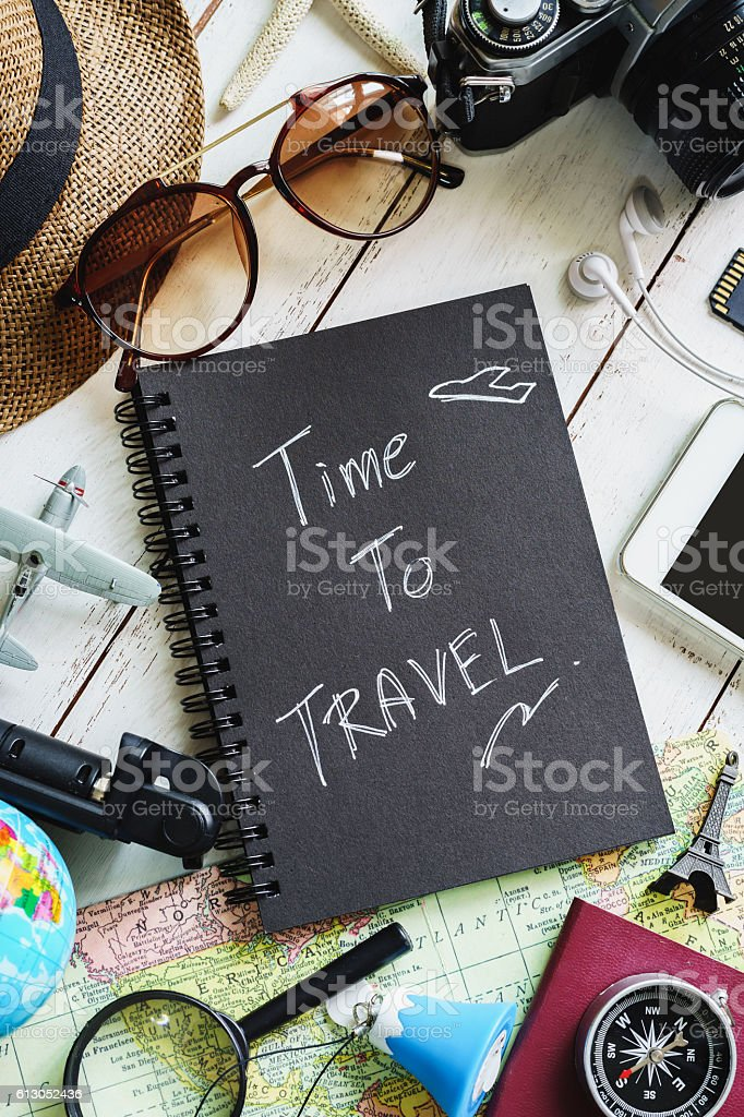 Traveler's accessories and items with black notebook stock photo