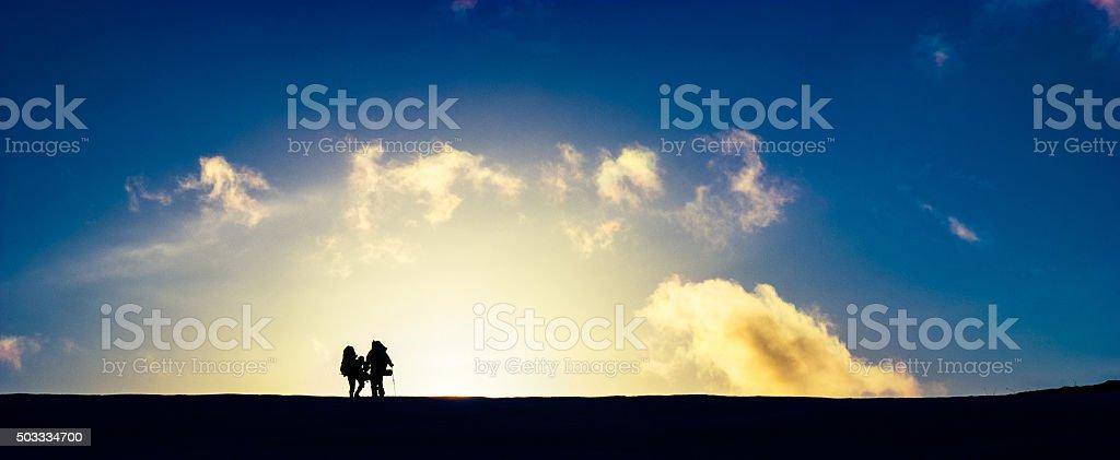 Travelers at beautiful sunset stock photo