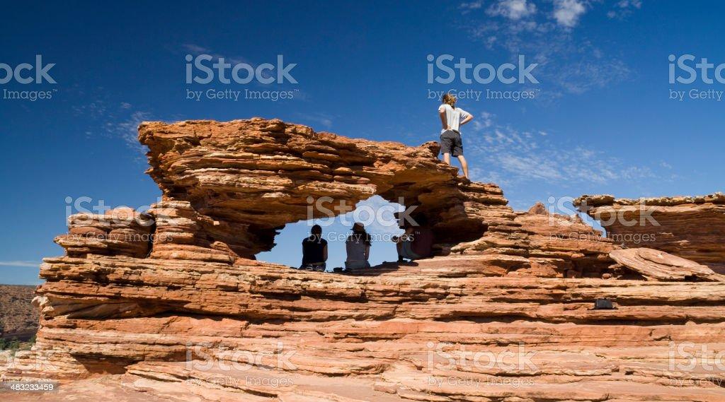 Travelers at 'Nature's Window' in Australia stock photo